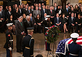 United States Senate Minority Leader Chuck Schumer (Democrat of New York) and United States Senate Majority Leader Mitch McConnell (Republican of Kentucky) lay a wreath at the casket containing the remains of former United States President George H.W. Bush during a ceremony honoring the former President, who will Lie in State in the Rotunda of the US Capitol on Monday, December 3, 2018.<br /> Credit: Ron Sachs / CNP<br /> (RESTRICTION: NO New York or New Jersey Newspapers or newspapers within a 75 mile radius of New York City)