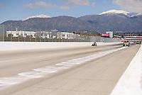Feb. 27, 2011; Pomona, CA, USA; NHRA safety safari crews clean up an oil down during the Winternationals at Auto Club Raceway at Pomona. Mandatory Credit: Mark J. Rebilas-
