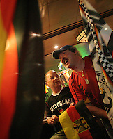 Fans of the German National soccer team celebrate their 4-2 victory over Costa Rica in the first round of the 2006 FIFA World Cup at a sports bar outside the Gelsenkirchen Train Station on Friday, June 9 2006. (ISI / Douglas Zimmerman)