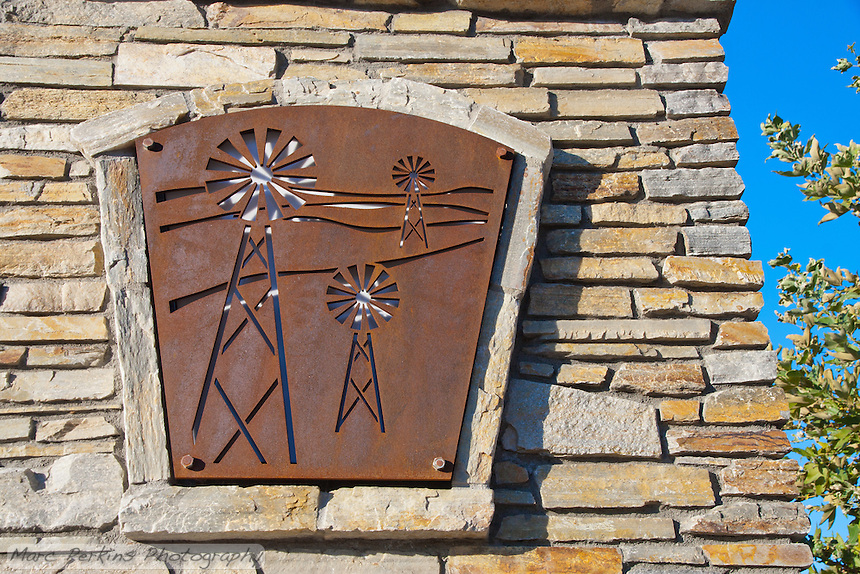 """Metallic cutouts with a windmill pattern are frequent in the Grand Ave. corridor; this one is on the large entrance sign on the eastern edge of the city.  This was part of the 2015 rebuild of the Grand Avenue and Longview Drive intersection for Diamond Bar's 2015 """"Grand Avenue Beautification"""" project, landscape architecture for the project was by David Volz Design."""