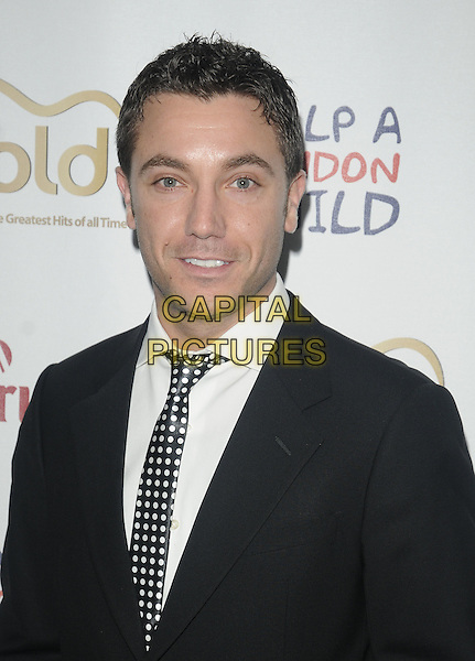 GINO D'ACAMPO.At the Marriott Burns Night Ball 2010, Marriott Hotel, Grosvenor Square, London, England, UK, .January 22nd 2010..portrait headshot white tie shirt  black suit polka dot .CAP/CAN.©Can Nguyen/Capital Pictures