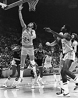 Golden State Warrior Rick Barry scores against the <br />