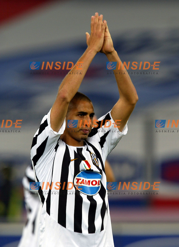 Torino 12/5/2004 Italy Cup final <br /> Juventus - Lazio 2-2 <br /> David Trezeguet (Juventus) saluta i tifosi al termine della partita. <br /> David Trezeguet (Juventus) salutes Juventus fans at the end of the match in the Italian Cup final second leg match at the Delle Alpi Stadium in Turin May 12, 2004. Lazio won the first match in Rome 2-0 and the second match ended in a 2-2 draw<br /> Photo Insidefoto