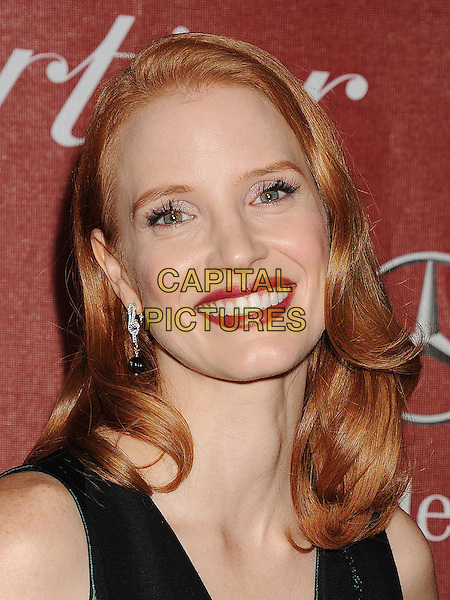 Jessica Chastain.The 2012 Palm Springs Film Festival Awards Gala at the Palm Springs Convention Center in Palm Springs, California, USA..January 7th, 2012.headshot portrait hair retro lipstick beauty make-up smiling green v-neck silk sleeveless.CAP/ROT/TM.©Tony Michaels/Roth Stock/Capital Pictures