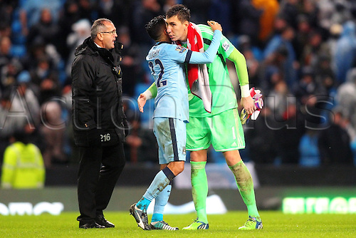 01.01.2015.  Manchester, England. Barclays Premier League. Manchester City versus Sunderland. Former team mates Sunderland goalkeeper Costel Pantilimon and Manchester City defender Gael Clichy hug each other after the game