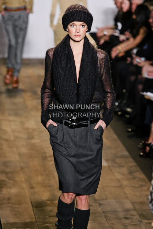 Lindsay Ellingson walks the runway in a anthracite mohair voile pullover, and anthracite covert trouser skirt at the Michael Kors Fall 2010 runway fashion show, during Mercedes-Benz Fashion Week Fall 2010.