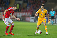 Alexandru Dedov of Moldova takes on Chris Gunter of Wales during the FIFA World Cup Qualifier match between Wales and Moldova at Cardiff City Stadium, Cardiff, Wales on 5 September 2016. Photo by Mark  Hawkins.