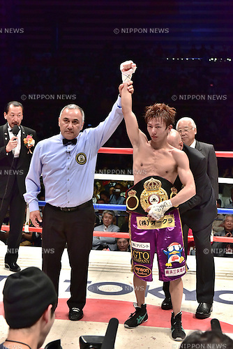 Ryoichi Taguchi (JPN),<br /> MAY 6, 2015 - Boxing :<br /> Ryoichi Taguchi of Japan has his arm raised by referee Ferlin Marsh as he celebrates with his champion belt after winning the WBA light flyweight title bout at Ota-City General Gymnasium in Tokyo, Japan. (Photo by Hiroaki Yamaguchi/AFLO)