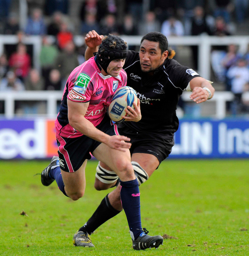 Cardiff's Leigh Halfpenny tries to outpace Falcons' Josh Afu..Photo: Richard Lee/Richard Lane Photography. Newcastle Falcons v Cardiff Blues. Amlin Challenge Cup Quarter Final. 11/04/2010.