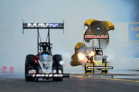 Oct. 6, 2012; Mohnton, PA, USA: NHRA engine of top fuel dragster driver Spencer Massey  burns as he slows alongside Brandon Bernstein during qualifying for the Auto Plus Nationals at Maple Grove Raceway. Mandatory Credit: Mark J. Rebilas-
