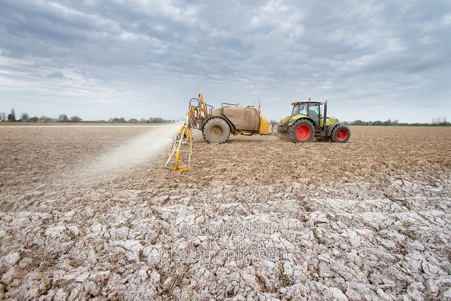 Applying liquid NPK fertilser to potato land - April, Lincolnshire