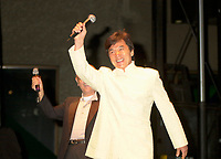 Actor & film maker Jackie Chan (R)  get on stage with World Film Festival's President  Serge Losique (L)( the free outdoor  projection of one of Chan's movie `. at the 25th World Film Festival,Sept 1st 2001 in Montreal, CANADA.<br /> <br /> Apprenticed to the Peking Opera by his parents at the age of 6, Jackie Chan was rigorously trained in music, dance, and traditional martial arts. A visiting filmmaker offered Chan his first (tiny) role as a stunt player. Chan took the part, and soon left the Opera to pursue the world of film. Fellow Opera students Biao Yuen and Sammo Hung Kam-Bo would also have careers in film, and the three would star in several films together in the following years. Chan's talent and enthusiasm soon saw him taking larger and more important roles, graduating first to stunt coordinator, and then to director. <br /> <br /> <br /> <br /> Following the death of martial arts legend Bruce Lee, the search was on for an actor who could inspire audiences to the same degree; every young martial artist was given a chance. Chan decided that rather than emulating Lee (and thus living forever in his shadow), he would develop his own style of filmmaking. His directorial debut Shi di chu ma (1980) was a milestone in martial arts films, being the first to effectively combine comedy with action. This set the tone for many of his future films, which combined slapstick humor with high-energy martial arts action. A self-confessed fan of Buster Keaton and Harold Lloyd, Chan performs all his own stunts, quite often at his own peril. His later films include outtakes of his on-set injuries run under the closing credits. He is the world number one in his field