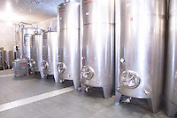Stainless steel fermentation tanks in varying sizes in the winery. Vukoje winery, Trebinje. Republika Srpska. Bosnia Herzegovina, Europe.