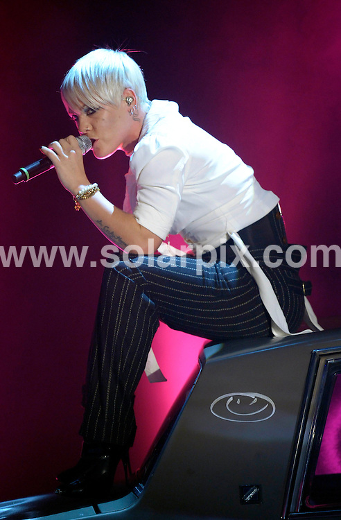 **ALL ROUND PICTURES FROM SOLARPIX.COM**.**SYNDICATION RIGHTS FOR UK AND SPAIN ONLY**.The American pop singer Pink during the German TV show 'I Bet!' hosted by Thomas Gottschalk in Berlin  Germany...JOB REF:7836-CPR/Jens Schlueter    DATE:08-11-08.**MUST CREDIT SOLARPIX.COM OR DOUBLE FEE WILL BE CHARGED* *UNDER NO CIRCUMSTANCES IS THIS IMAGE TO BE REPRODUCED FOR ANY ONLINE EDITION WITHOUT PRIOR PERMISSION*