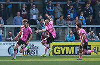 celebrations as goal scorer Shaun Brisley of Northampton Town makes it 3-1 during the Sky Bet League 2 match between Wycombe Wanderers and Northampton Town at Adams Park, High Wycombe, England on 3 October 2015. Photo by Andy Rowland.