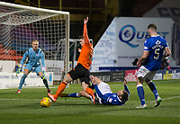 16th November 2019; Tannadice Park, Dundee, Scotland; Scottish Championship Football, Dundee United versus Queen of the South; Kevin Holt of Queen of the South tackles Cammy Smith of Dundee United  - Editorial Use