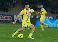 Marek Hamsik   in action during the Italian Serie A soccer match between SSC Napoli and Genoa CFC   at San Paolo stadium in Naples, February 24 , 2014