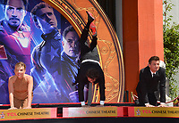 """LOS ANGELES, USA. April 23, 2019: Scarlett Johansson, Mark Ruffalo & Jeremy Renner at the handprint ceremony for the cast of """"Avengers: Endgame"""" at the TCL Chinese Theatre.<br /> Picture: Paul Smith/Featureflash"""