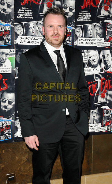 "SIMON PHILLIPS .At the UK Film Premiere of ""Jack Falls"", The May Fair Hotel, London, England, UK, March 14th 2011..half length black suit tie hand in pocket  .CAP/CAN.©Can Nguyen/Capital Pictures."