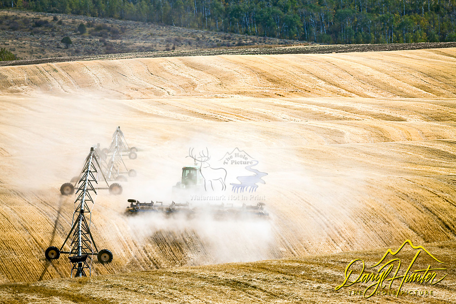 A farmer tilling  his field in Eastern Idaho