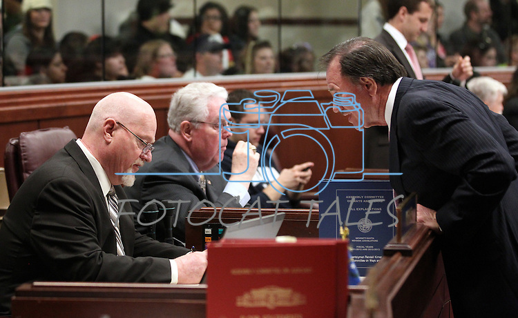 Nevada Assembly Republicans, from left, Randy Kirner, John Hambrick and Richard McArthur, work on the Assembly floor at the Legislature in Carson City, Nev., on Monday, March 21, 2011. Photo by Cathleen Allison