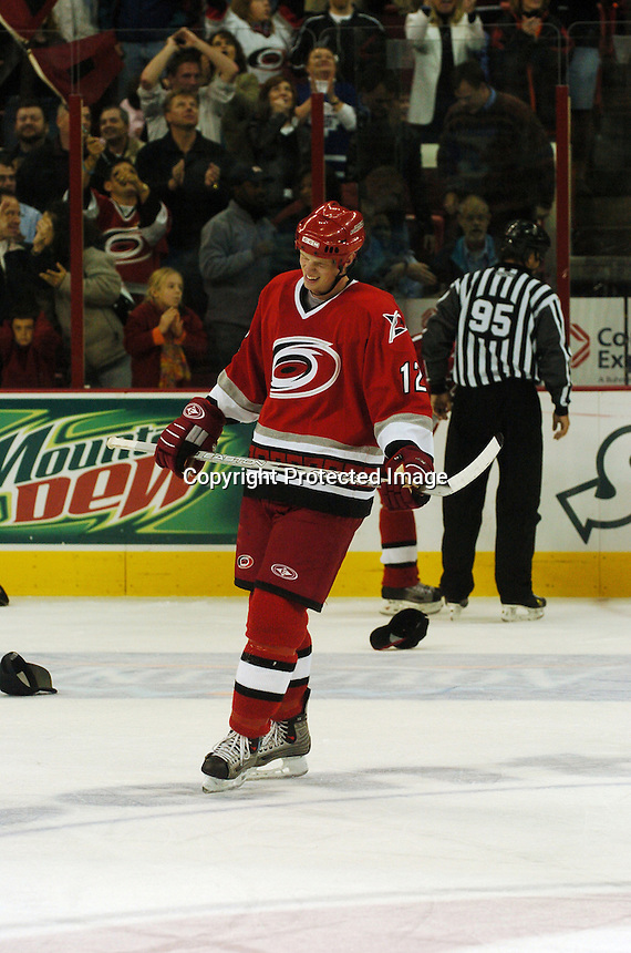 Carolina Hurricanes' Eric Staal skates as fans toss hats to the ice thinking he had a hat trick against the Toronto Maple Leafs Tuesday, Nov. 3, 2005 in Raleigh, NC. His third goal was called back by officials, but Carolina won 4-3.