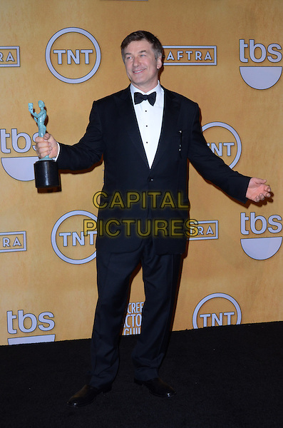 Alec Baldwin.Pressroom at the 19th Annual Screen Actors Guild Awards held at The Shrine Auditorium, Los Angeles, California, USA..27th January 2013.SAG SAGs full length black tuxedo bow tie white shirt award trophy winner hands arms.CAP/ADM/TW.©Tonya Wise/AdMedia/Capital Pictures.