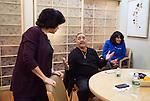 Randi Kaplan, caregiver support center staff, talks with Elvin Olivera at Montefiore Medical Center in the Bronx, New York on Monday, December 5, 2016.