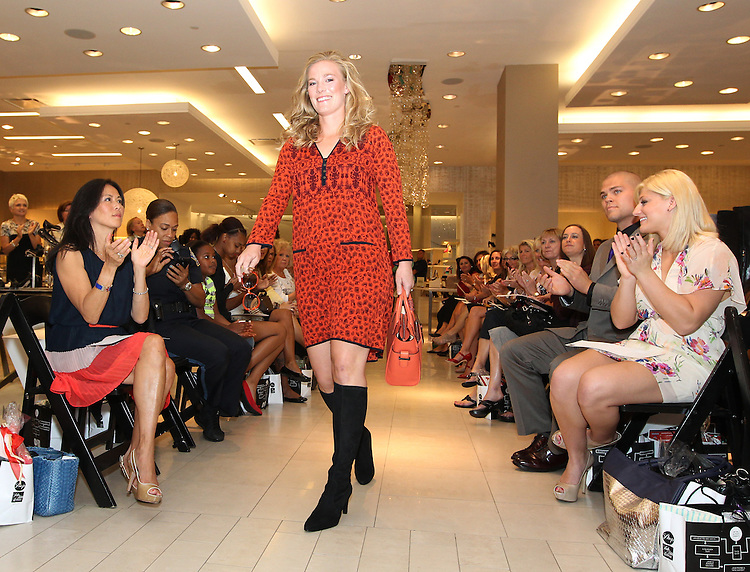 BOSTON -- Katie Miller, wife of Boston Red Sox pitcher Andrew Miller, walks the runway during the From Fenway to the Runway charity fashion show benefitting the Red Sox Foundation at Saks Fifth Avenue on Thursday, Sept. 13, 2012. (Brita Meng Outzen/Boston Red Sox)