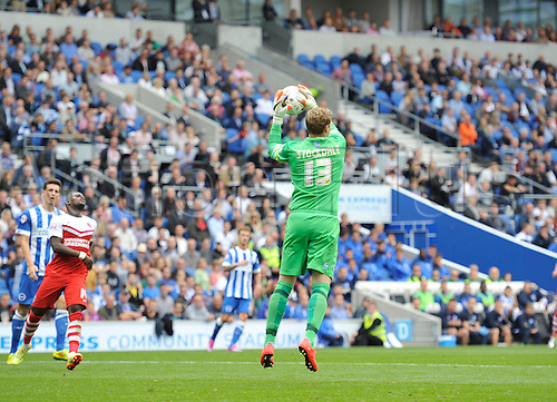 30.08.2014.  Brighton, England. Sky Bet Championship. Brighton and Hove Albion versus Charlton Athletic. Brighton's David Stockdale makes an easy save from the crossed ball