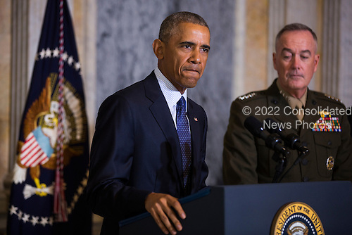 United States President Barack Obama (L) speaks on the Orlando shooting at the Treasury Department while Chairman of the Joint Chiefs of Staff General Joseph Dunford (R) look on in Washington, DC, USA, 14 June 2016. Obama used the opportunity to directly attacked Donald Trump's proposal to ban Muslims from entering the United States<br /> Credit: Jim LoScalzo / Pool via CNP