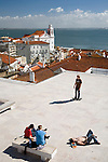Young people sunbathing at Santa Luzia viewpoint, Lisbon, Portugal