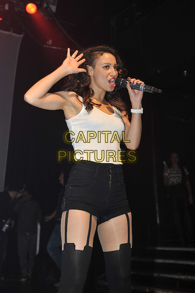 Amelle Berrabah.performing at the SBTV Christmas Party, Koko, Camden, London, England..21st December 2011.on stage in concert live gig performance half length black white stockings hold ups shorts tank top singing hand arm.CAP/MAR.© Martin Harris/Capital Pictures.