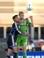 Chris Wondolowski of Earthquakes battles for the ball in the air against Andy Rose of Sounders during the game at Buck Shaw Stadium in Santa Clara, California on August 11th, 2012.   Earthquakes defeated Sounders, 2-1.