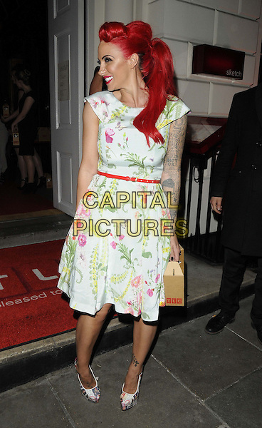 Jodie Marsh.attended the TLC new American TV channel launch party, Sketch bar & restaurant, Conduit St., London, England, UK, 25th April 2013..full length tattoo red dyed hair white floral print dress belt waist vintage retro victory roll hair ponytail box holding make-up shoes smiling side profile .CAP/CAN.©Can Nguyen/Capital Pictures.