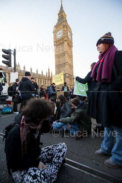 London, 19/01/2016. Today, students gathered in Parliament Square to protest against the British Government decision to scrap the maintenance grants. Then, protesters moved to occupy, symbolically and peacefully, Westminster Bridge. From the organisers Facebook page: &lt;&lt;This Tuesday, the Labour Party has called an opposition day debate on the scrapping of maintenance grants. We will be there to demand a reversal of this disgraceful attack on working class students, and to show that we will not let them get away with this. Last Thursday, it took just 18 MPs 90 minutes to scrap maintenance grants for the million poorest students. They did so without a debate in Parliament; in a backroom committee which most of the people these cuts are affecting will never have even heard of. And the ministers who made this decision benefitted from free higher education and grants themselves. This is not only a direct attack on working class students, but it also shows the government's flagrant disregard for the most basic democratic processes. The Tories are clearly scared of having their policies scrutinised and exposed to public anger. [&hellip;]&gt;&gt;.<br />