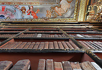 Looking up at the bookcases with Chinese motifs, lacquer and gilding by Manuel da Silva, to the ceiling with allegorical trompe l'oeil frescoes painted by Antonio Simoes Ribeiro and Vicente Nunez, in the Black Room of the Joanina Library, or Biblioteca Joanina, a Baroque library built 1717-28 by Gaspar Ferreira, part of the University of Coimbra General Library, in Coimbra, Portugal. The Casa da Livraria was built during the reign of King John V or Joao V, and consists of the Green Room, Red Room and Black Room, with 250,000 books dating from the 16th - 18th centuries. The library is part of the Faculty of Law and the University is housed in the buildings of the Royal Palace of Coimbra. The building is classified as a national monument and UNESCO World Heritage Site. Picture by Manuel Cohen