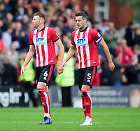 Lincoln City's Cian Bolger, left, and Jason Shackell at the end of the game<br /> <br /> Photographer Andrew Vaughan/CameraSport<br /> <br /> The EFL Sky Bet League One - Lincoln City v Sunderland - Saturday 5th October 2019 - Sincil Bank - Lincoln<br /> <br /> World Copyright © 2019 CameraSport. All rights reserved. 43 Linden Ave. Countesthorpe. Leicester. England. LE8 5PG - Tel: +44 (0) 116 277 4147 - admin@camerasport.com - www.camerasport.com