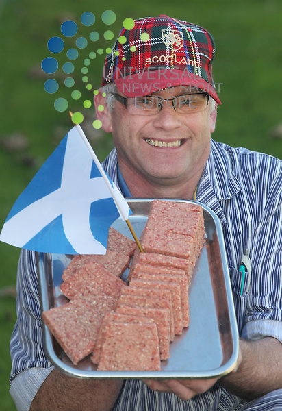 "Scotland crowned a new Sausage King today when John McIntosh,56, was named  winner of the Best Sausage in Scotland Award. Over 75 butchers where sampled and Hendries Butchers of Girvan in the west of Scotland was awarded the top spot with John's square slice sausage. He said: ""I couldn't believe it. I was overwhelmed. My legs are still shaking. I thought we had won the award for the south-west district, not for the whole of Scotland."" John has been a butcher since he was 15 and owns Hendries Butchers of Girvan. And his secret? He said: ""It's an old recipe which we have had for years. We mix it the traditional way - with our hands and then add in the seasoning which is our secret of success."" Picture: /Universal News And Sport (Scotland). 5 October  2012. www.unpixs.com."