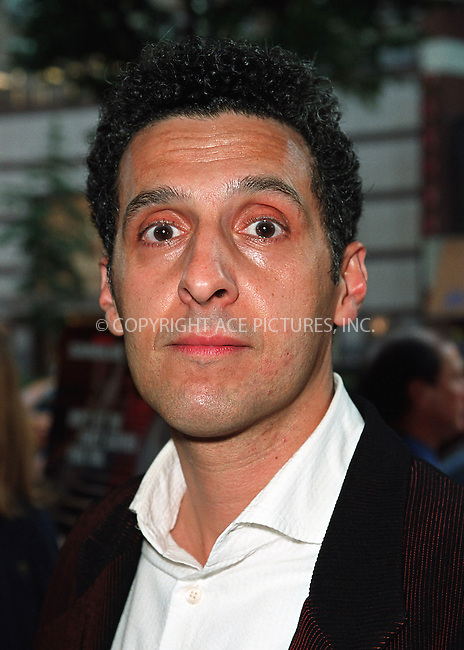 John Turturro arrives at the world premiere of Mr. Deeds in New York. June 18, 2002. Please byline: Alecsey Boldeskul/NY Photo Press.   ..*PAY-PER-USE*      ....NY Photo Press:  ..phone (646) 267-6913;   ..e-mail: info@nyphotopress.com