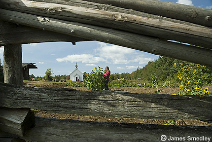 View through a wooden fence at an historical farm
