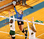 BROOKINGS, SD - OCTOBER 28: Ashlynn Smith #4 from South Dakota State tips the ball past McKenzie Burke #5 and Emily Halverson #9 from North Dakota State during their match Sunday afternoon at Frost Arena in Brookings. (Photo by Dave Eggen/Inertia)