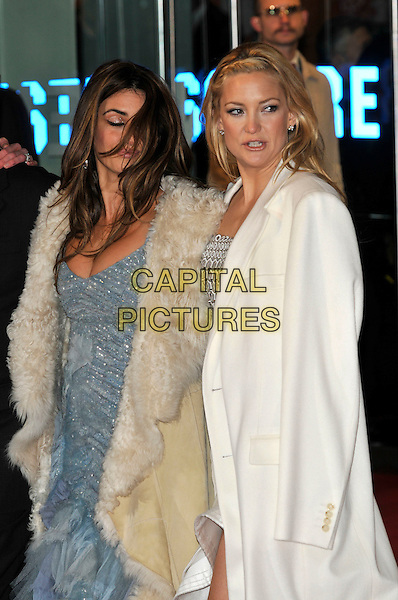 PENELOPE CRUZ, KATE HUDSON.'NINE' world film premiere.Odeon cinema Leicester Square, London, England.3rd December 2009.half length beige fur sheepskin coat lined silver beaded dress cream funny hair over face windy white .CAP/PL.©Phil Loftus/Capital Pictures.