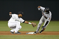 Second baseman Giovanny Alfonzo (6) of the Columbia Fireflies applies a tag to Oswaldo Cabrera (10) during a game against the Charleston RiverDogs on Wednesday, August 29, 2018, at Spirit Communications Park in Columbia, South Carolina. Charleston won, 6-1. (Tom Priddy/Four Seam Images)