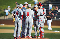 North Carolina State Wolfpack head coach Elliott Avent (9) has a meeting on the mound during the game against the Wake Forest Demon Deacons at David F. Couch Ballpark on April 18, 2019 in  Winston-Salem, North Carolina. The Demon Deacons defeated the Wolfpack 7-3. (Brian Westerholt/Four Seam Images)