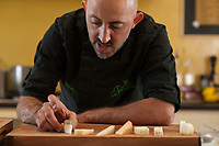 Chef Dario Ferreri at La Bandita, preparing plates of Peconrino cheese pairings, Val d' Orcia, Tuscany, Italy