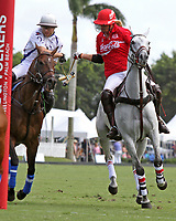 WELLINGTON, FL - MARCH 26: Valiente's Matias Torres Zavaleta and Coca Cola's Gillian Johnston (red jersey) battle for control as Valiente defeats Coca Cola 9-6 in the final of the 26 goal USPA Gold Cup, at the International Polo Club, Palm Beach on March 26, 2017 in Wellington, Florida. (Photo by Liz Lamont/Eclipse Sportswire/Getty Images)