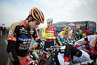 Wout Van Aert (BEL/Vastgoedservice-Golden Palace) checks the minutes to the start<br /> <br /> Koksijde CX World Cup 2014