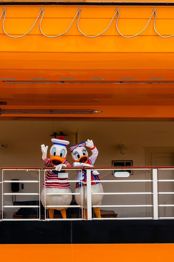 Donald and Daisy Duck welcoming passengers aboard the new Disney Dream cruise ship, Port Canaveral, Florida USA