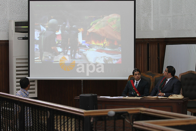Egyptian Prosecutions watch on screen showing as they attend a trial in Cairo on May 22, 2014. A total of 20 defendants in the case are charged with harming Egypt's national interests by spreading false news and assisting or belonging to a terrorist organization, but 12 are being tried in absentia. Photo by Mohammed Bendari